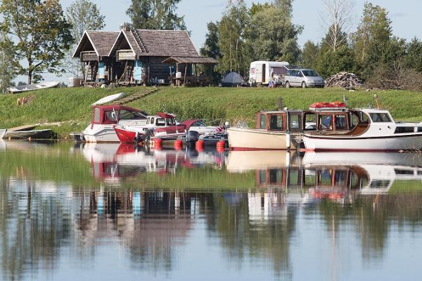 Fishing Village boat hire on the banks of the Sauga River. Come fishing or simply on a boat trip!