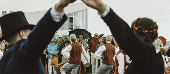 Dancers perform Estonian folk dances in traditional clothes.