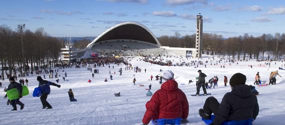 Children sledge down the hill of the Song Festival Grounds in Tallinn on Shrove Tuesday.