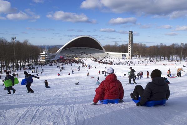 Children sledge down the hill of the Song Festival Grounds in Tallinn on Shrove Tuesday.