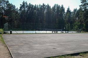 Tennis court and soccer field of the former community centre on Kihnu
