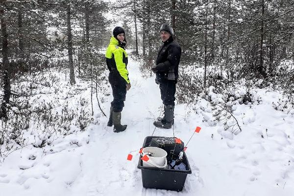 Winter walk in the forest and ice fishing