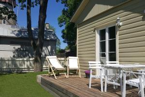 Kuresāres ģimenes apartamenti ar dārzu un terasi