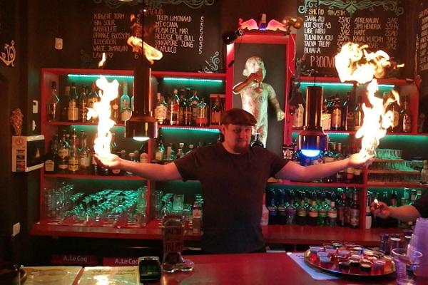 Bar Trepp and a barman doing tricks with fire