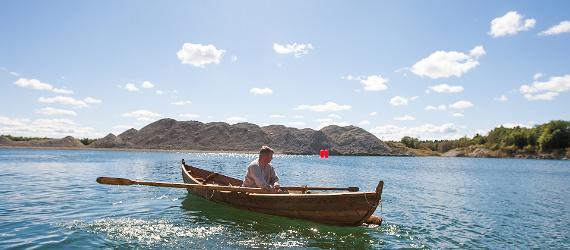 boat-on-river-man-visit-estonia