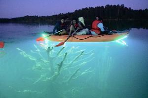 Trip on Lake Rummu with a lighted raft