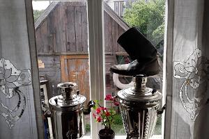 Samovars with kirza boots on the window