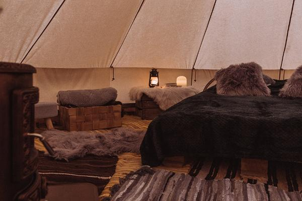 Glamping tent, cosy furnishings, candles