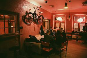 Bar Trepp and its cosy interior, a motorcycle on the wall, guests spending some lovely time