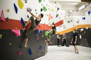 Enthusiasts on the climbing wall of Tartu Ministry of Climbing