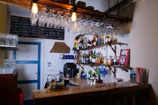 Ski shelves and menu at ULA bar