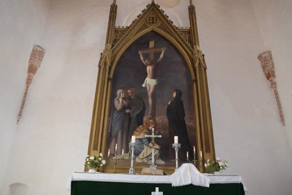"""Glezna uz altāra sienas """"Kristus krustā"""" R.J. v.z. Mühlen Rannu baznīcā"""
