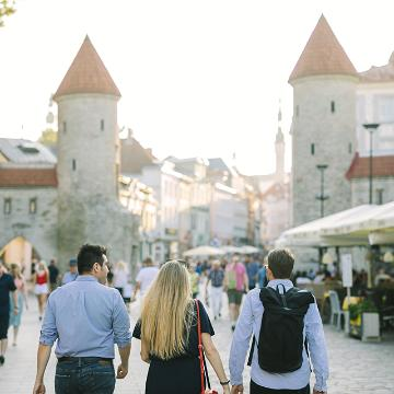 Three people walking in Tallinn Old town