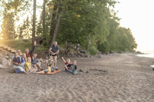 Ranna Recreation Centre, people on the sandy beach of Lake Peipus