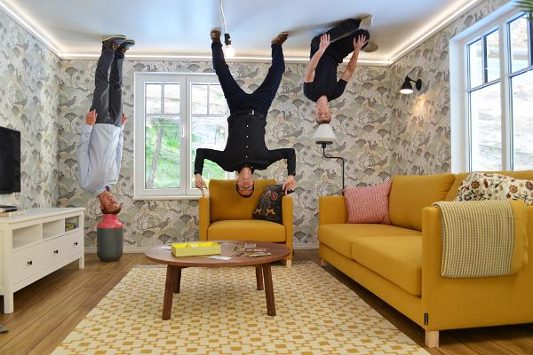 Visitors standing on the ceiling in the Upside Down House