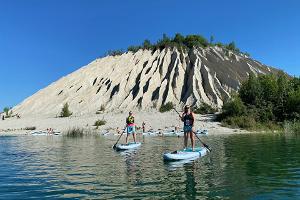 Adventurous standup paddleboarding in Rummu quarry