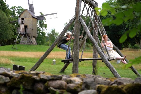 Village swing and windmill in Mihkli Farm Museum