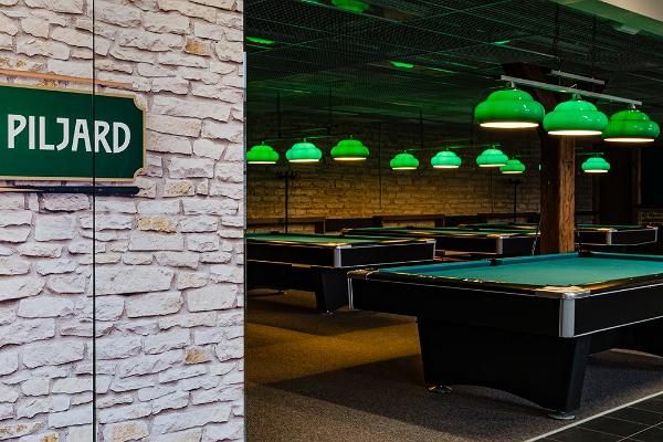 Billiards tables, green ceiling lamps