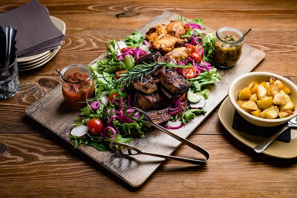 Grilled dish on a wooden tray