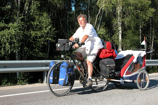 A man riding a bicycle on road