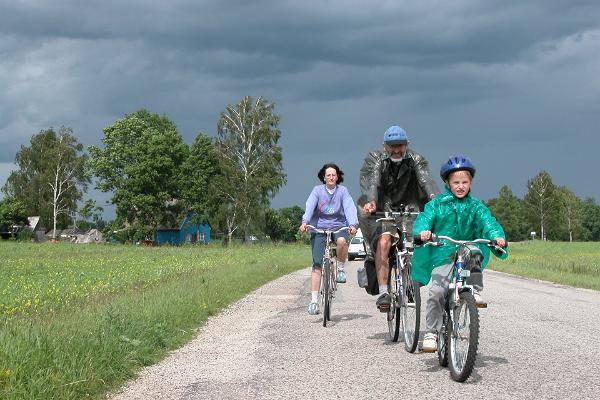 Woman, man and a child on a bicycle